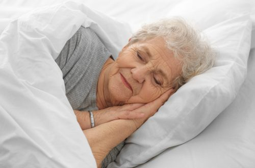 Elderly woman sleeping in bed